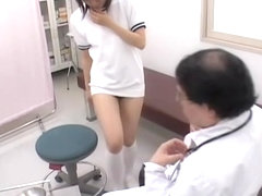 Asian bun of short haired girl gets examined by gynecologist