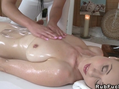 Masseuse rubs oil to sexy natural busty blonde