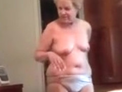 Granny filmed by hubby dressing