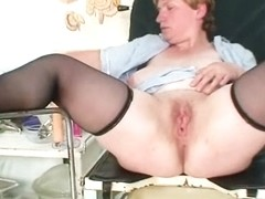 Unpretty chubby mature toys herself with gyno speculum