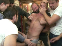 Bound in Public. A mob of men punish a thief with a giant cock