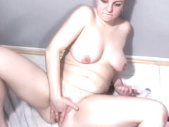 Lustful babe with big boobs and a lovely butt gets her pussy stretched