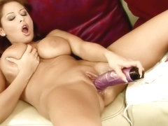Gorgeous young blonde moans while having her twat penetrated with a dildo