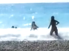 Accidental nudity shown in wavy water