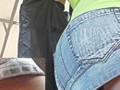 Chick in jean short show tattoo in candid upskirt video