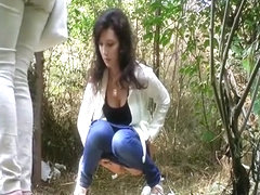 Busty chick pees in nature