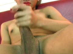 Dark skinned femboy pulls out big shecock and wanks it
