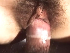 Skinny Japanese milf pussy stuffed with a rubber coated prick