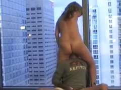 Man eats his wife's pussy by the window