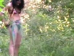 Dark hair woman in bikini take a pee