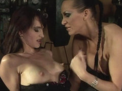 Mandy Bright fingering a hot chick in a machine shop