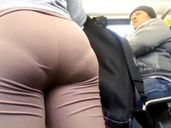 Large Wazoo in Brown Leggings showing unfathomable panty line