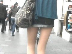 Upskirt pretty brunette in town, wearing pantyhose and laced undies