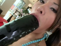 A hot Asian destroys her own anus for beads